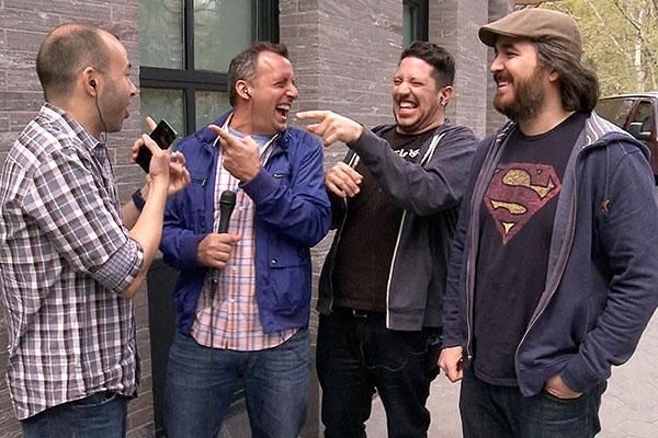 Four men laughing