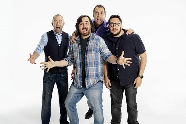 Four men smiling